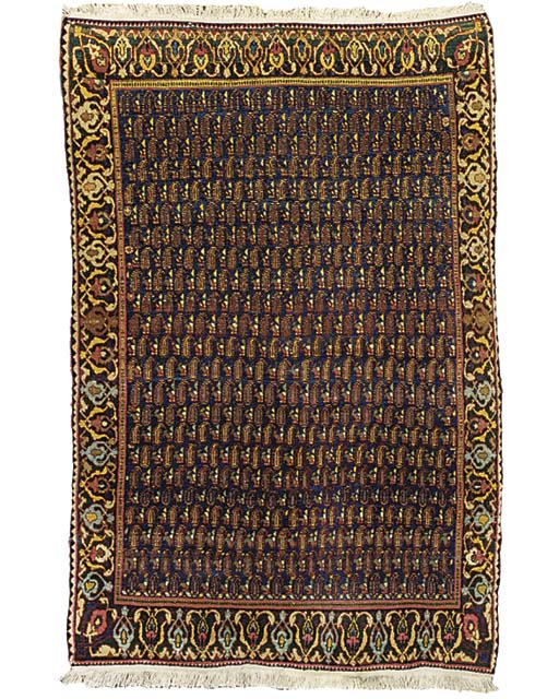 A PERSIAN TRIBAL RUG
