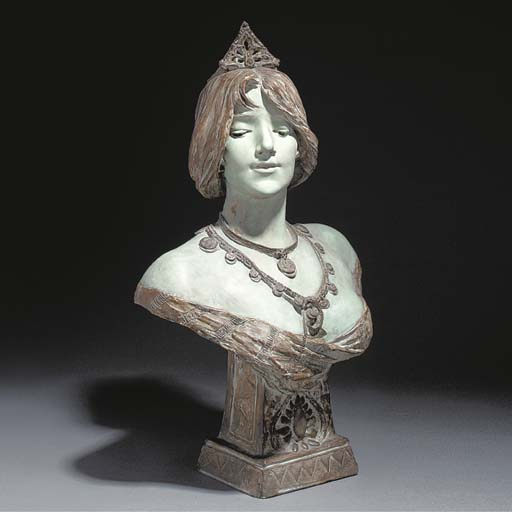 An enamelled terracotta bust