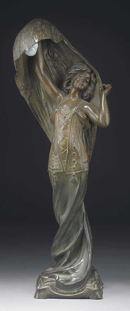 A patinated spelter figural la