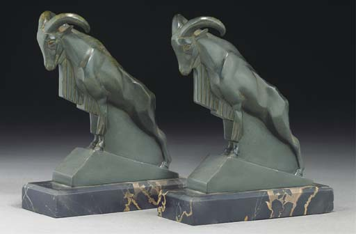 A pair of green patinated spel
