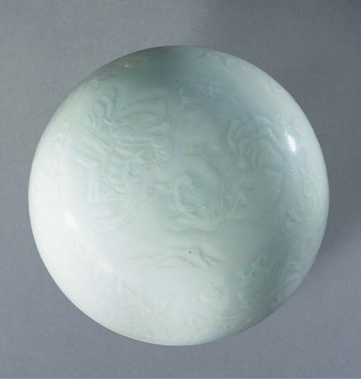 A blueish-white glazed domed c