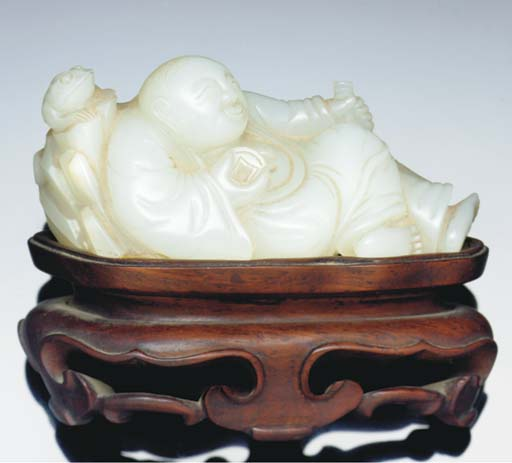 A white jade carving of a recl