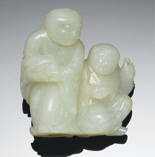A white jade carving of two fi