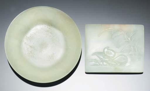 A celadon jade plaque with qua