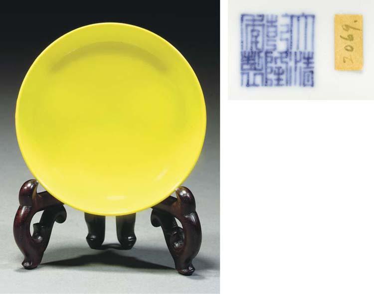 A lemon yellow glazed saucer d