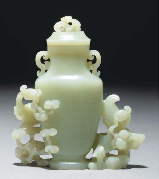 A celadon jade vase and cover,