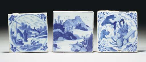 Three blue and white square ti