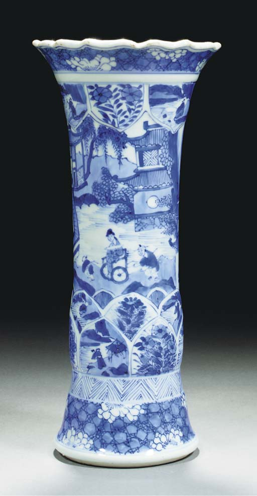 A blue and white flaring vase,