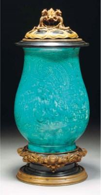 A turquoise glazed pear shaped