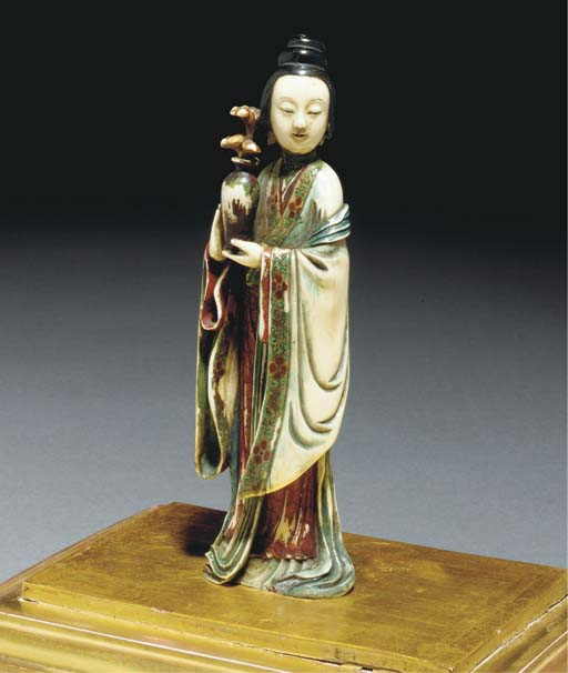 A stained ivory carving of a l