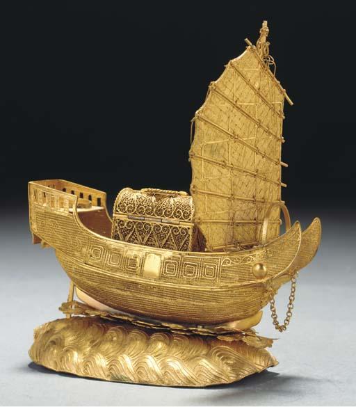 A gold filigree model of a jun