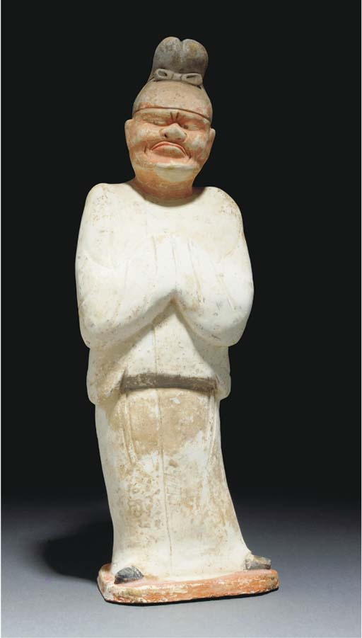 A painted pottery figure of an