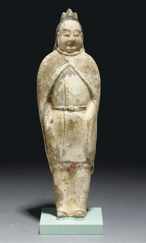 A painted pottery figure an at