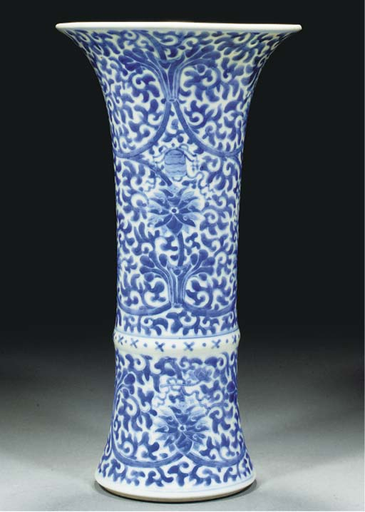 A blue and white trumpet vase,