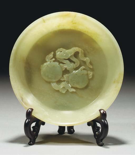 A celadon jade flaring bowl, 1