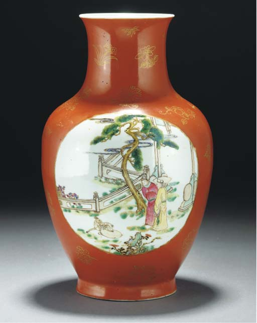 A coral ground baluster vase,