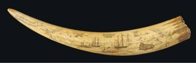 A SCRIMSHAW-DECORATED WALRUS T