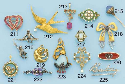 A gold, diamond swallow brooch