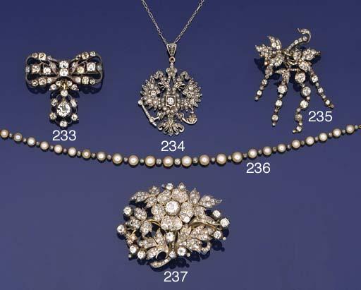 An Edwardian diamond and half-