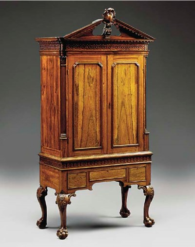 A ROSEWOOD CABINET ON STAND