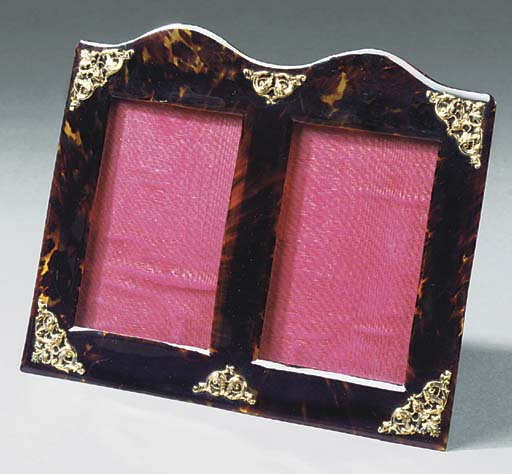 A LATE VICTORIAN OR EDWARDIAN TORTOISESHELL DOUBLE PHOTOGRAPH FRAME