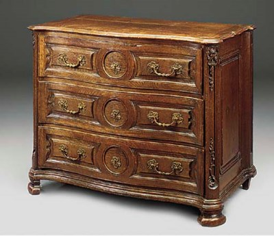 A DUTCH OAK SERPENTINE COMMODE