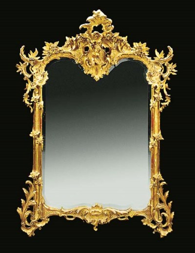 A FRENCH GILT COMPOSITION MIRR