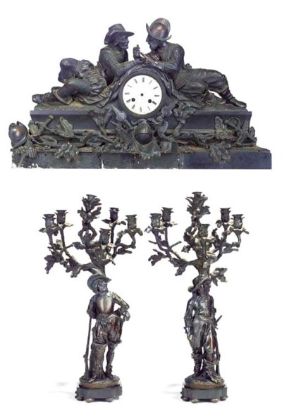 A FRENCH BRONZE MANTEL CLOCK A
