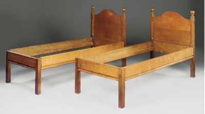 A PAIR OF OAK SINGLE BEDS