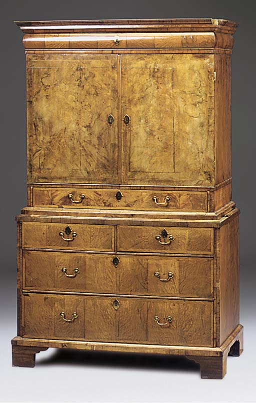 A WALNUT BURR-VENEERED AND CROSSBANDED CABINET ON CHEST