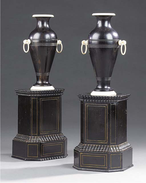 A PAIR OF VICTORIAN LIGNUM VITAE AND IVORY ORNAMENTAL URNS