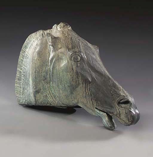 A BRONZE MODEL OF A HORSES HEA