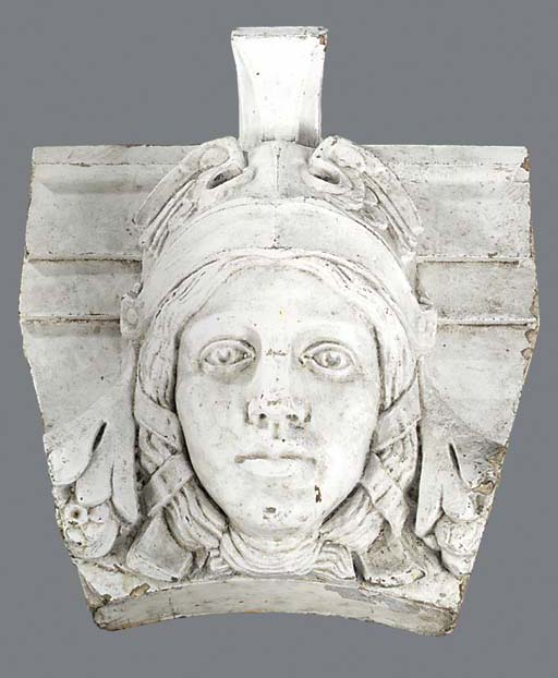 A WHITE PAINTED CARVED STONE KEYSTONE