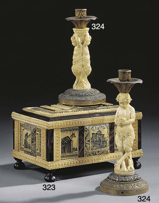 TWO CARVED IVORY AND GILT META