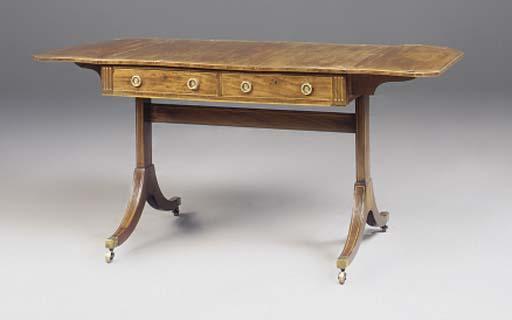 A LATE GEORGE III MAHOGANY AND CASUARINA OAK SOFA TABLE