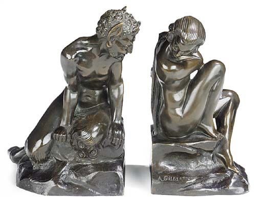 A PAIR OF BRONZE BOOKENDS MODE
