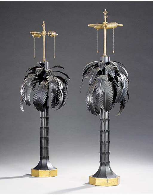 A PAIR OF BLACK AND GILT TOLE TABLE LAMPS
