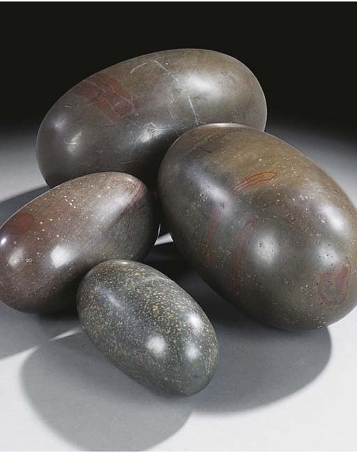 A collection of four stone spe
