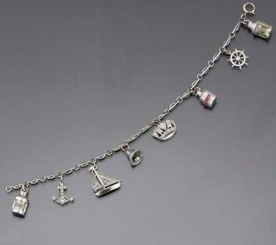 A diamond and gem-set charm br