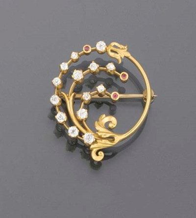 A diamond and ruby brooch,