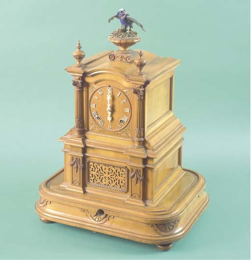 A satinwood automaton clock