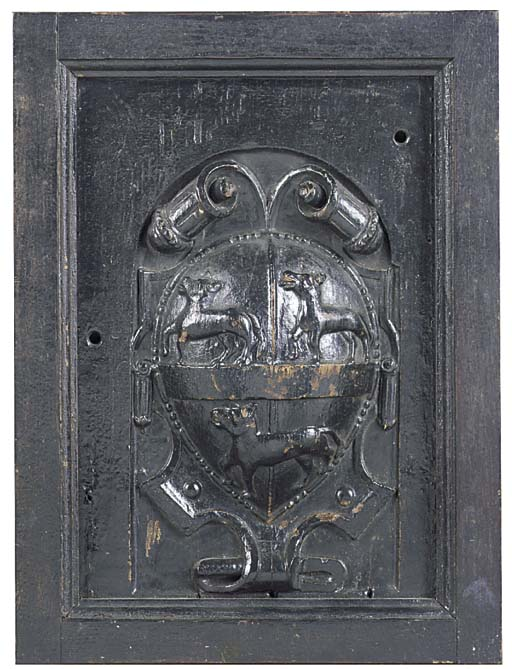 A carved wood armorial panel