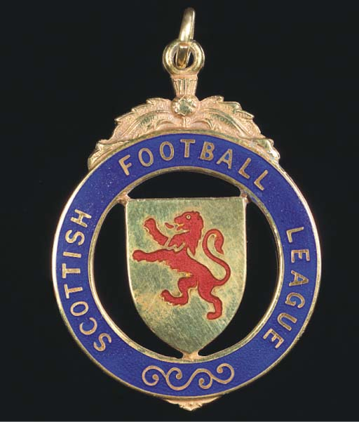 A 9CT GOLD AND ENAMEL MEDAL