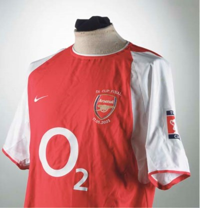 A RED AND WHITE ARSENAL SHORT-