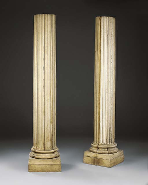 A pair of carved oak architect