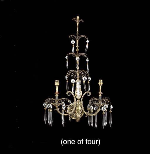 Four gilt bronze and cut glass