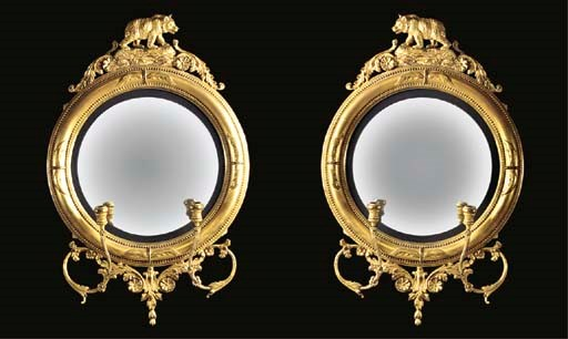 A pair of moulded gilt convex