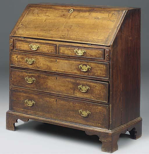 An oak and inlaid bureau
