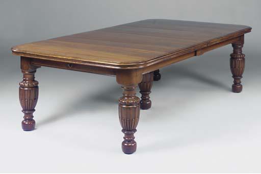A Victorian oak extending dini