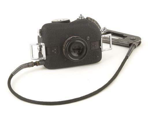 F21 button camera no. 33154
